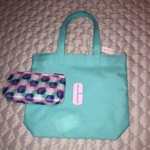NWT Clinique reversible tote& makeup bag w zipper.